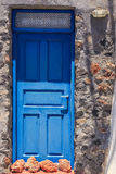 The doors of Greece. Blue doors at Santorini village Oia with stones, Greece island royalty free stock images
