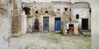 Doors in the Sassi in Matera. Doors of various sizes and colors in the Sassi, the old town of Matera in Basilicata, Italy.  The Sassi are a UNESCO World Heritage Royalty Free Stock Photography