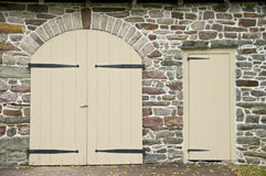 Doors in Stone Wall Royalty Free Stock Photos