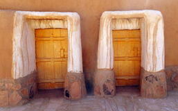 Doors to Homes in the Town of Al Qassim, Kingdom of Saudi Arabia. The photographer noticed two things about this scene to the reconstructed mud village of Al Stock Photos
