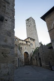 The doors and the tower. The medieval towers of the Tuscan village stock images