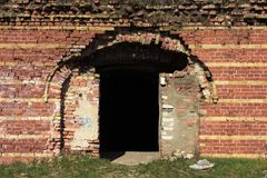 Doors in a very old red brick fortress stock image
