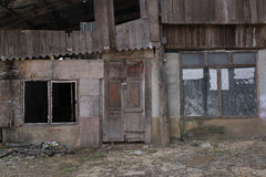 Doors and windows of abandoned house. Doors and windows of abandoned wooden house Stock Photography