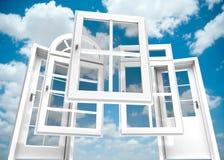 Doors and windows catalogue, sky. Selection of doors and windows with a blue sky on the background Royalty Free Stock Photo