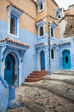 Doors and windows at Maroc. A street with many doors and windows at Chaouen royalty free stock photography