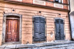 Doors and windows to a building in Cesky Krumlov stock image
