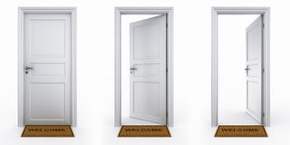 Doors With Welcome Mat Royalty Free Stock Photo
