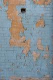 Doorstane bakstenen muur Stock Afbeelding