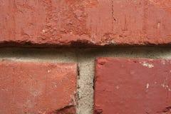Doorstane bakstenen muur, Stock Afbeelding