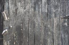 Doorstane de verticaal schilderde zwarte houten raadsachtergrond met h Royalty-vrije Stock Afbeelding