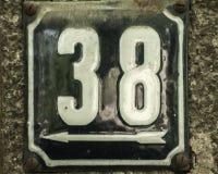 Doorstane geëmailleerde plaat nummer 38 Stock Foto's