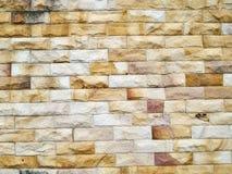 Doorstane grijze bakstenen muur Stock Afbeelding