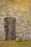 Doorstane houten deur Stock Foto