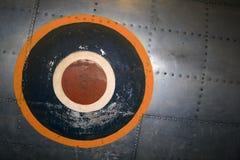 Doorstane insignes op vliegtuig Royalty-vrije Stock Afbeeldingen