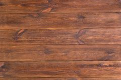 Doorstane oude bruine rustieke houten plankenachtergrond Lijstbovenkant stock afbeelding