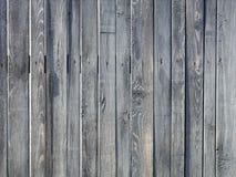 Doorstane oude grijze houten omheining Stock Foto