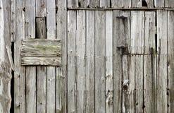 Doorstane oude houten schuurachtergrond Stock Foto