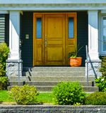 Doorsteps to the entrance of family house with landscaped front yard royalty free stock photography