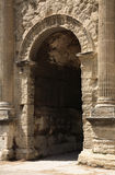 Doorway. An arched doorway in the stone wall Royalty Free Stock Photography
