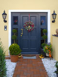Doorway. Historical wooden front door decorated with garland Royalty Free Stock Photography