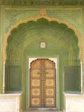 Doorway. The City Palace of Jaipur is a blend of traditional Rajasthan and Mughal architecture Royalty Free Stock Images