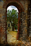 Doorway at ancient ruins. A view through a doorway or archway found at old ruins in southern France Royalty Free Stock Photo