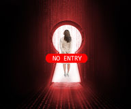 Doorway blocked by no entry sign with businesswoman Stock Image