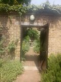 Doorway. Brick doorway with shrubs and a gravel path Royalty Free Stock Photos