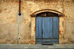 Doorway in brick wall stock photography