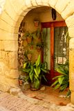 Doorway decorated with shells and plants stock photo