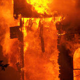 Doorway fire. Doorway structure wrapped in heavy flames Stock Photo