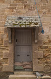 Doorway with flood defence sand bags Royalty Free Stock Photo