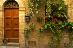 Doorway with flowers Stock Photos