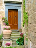 Doorway among the flowers Royalty Free Stock Images