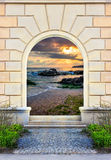 Doorway Frame with steps and picture inside. Frame of desolate immured door with picture of sea shore morning  and steps of cut stone Royalty Free Stock Photo