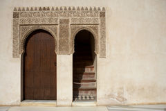 Doorway and islamic detail. Which reads there is no conqueror but god above the door in the patio de comares in the alhambra palace granada spain andalucia Stock Photos