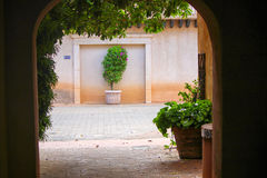 Through the Doorway. Looking through the doorway and into the alley in a village in Arizona Stock Image