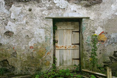 Doorway in old house. Exterior of dilapidated old house with door royalty free stock photos