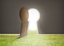 Doorway opening to bright light with grass Stock Photo