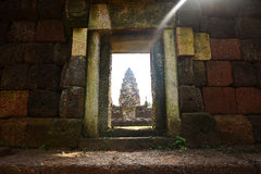 Doorway and sculpted wall in angkor Stock Images
