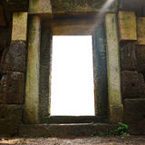 Doorway and sculpted wall in angkor,siem reap,camb Stock Image
