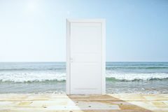 Doorway spliting wooden floor and ocean Royalty Free Stock Image