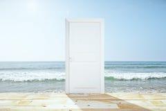 Doorway spliting wooden floor and ocean. Close up Royalty Free Stock Image