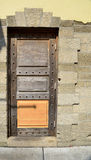 Doorway in St. Augustine, Florida. Old wooden doorway against brick wall in St. Augustine, Florida royalty free stock photos