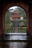 Doorway and Temple, Vietnam. Traditional Chinese-influence architecture at the Minh Mang royal tombs near Hue, Vietnam Royalty Free Stock Images