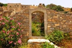 Doorway to ruins with wildflowers, Spinalonga Island, Crete, Greece Royalty Free Stock Image