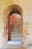 Doorway to the stairs. Inside medieval castle Stock Photography