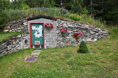 Doorway to underground home. Colorful doorway of a brick and stone entrance to a home built underground into a hillside Stock Images