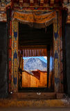 Doorway with view of mountains at Drak Yerpa monastery near Lhasa, Tibet Royalty Free Stock Photos