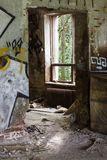 Doorway and window in abandoned building Stock Image